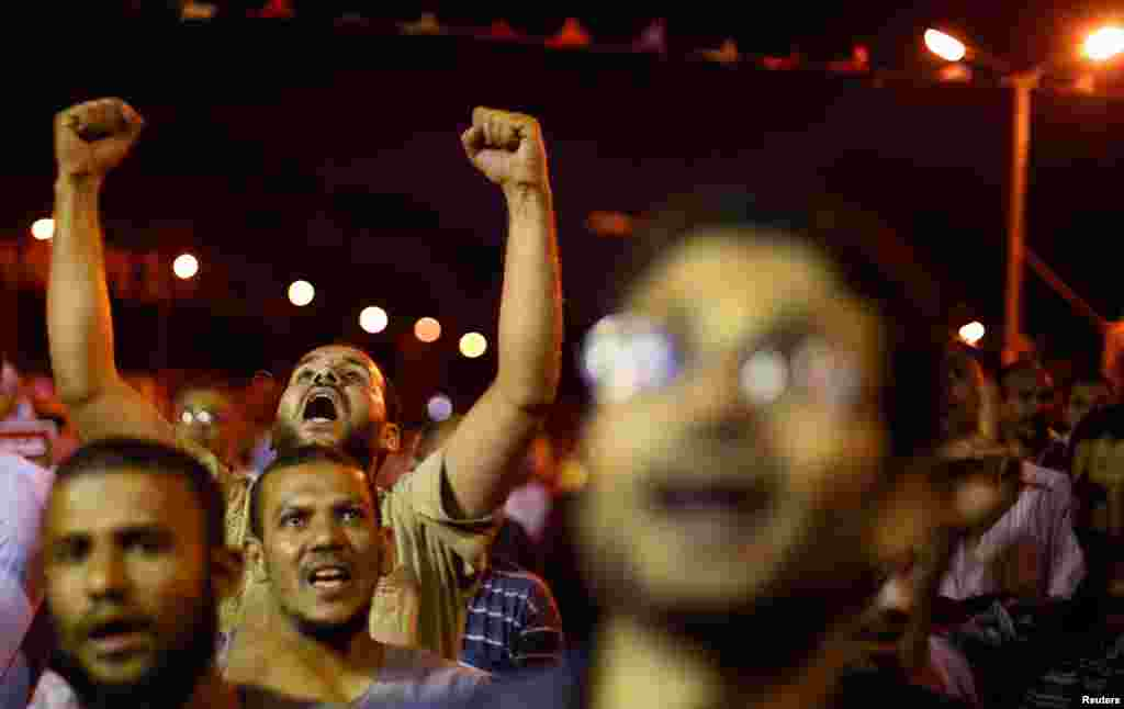 Supporters of the ousted Egyptian President Mohamed Morsi shout anti-army slogans during a sit-in protest in Cairo July 11, 2013.