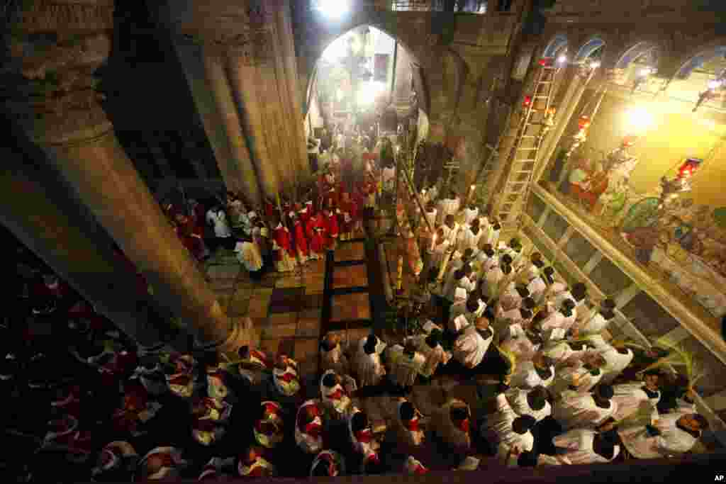 Christian clergymen carry palm fronds during the Palm Sunday procession in the Church of the Holy Sepulcher, traditionally believed by many to be the site of the crucifixion, in Jerusalem's Old City.