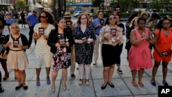People gather as community leaders speak during the End Gun Violence Candlelight Vigil in recognition of Gun Violence Awareness Month, Wednesday, June 1, 2016, in New York. (AP Photo/Julie Jacobson)