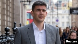 Google's Northern Europe boss Matt Brittin leaves a British parliamentary Public Accounts Committee inquiry into tax avoidance at Portcullis House in London, May 16, 2013.