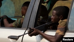 FILE - Former Seleka soldiers are shown in January 2014. A rebel leader and ex-defense minister under Seleka called Wednesday for autonomy, followed by full independence.