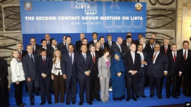 Italian Foreign Minister Franco Frattini, center, poses with the other delegates during a group photo following a meeting on how to support rebels fighting the Libyan leader Moammar Gadhafi, at Rome's Foreign Ministry, May 5, 2011