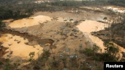 FILE - An area deforested by illegal gold mining is seen in a zone known as Mega 13, at the southern Amazon region of Madre de Dios, Peru, Jan. 25, 2014.