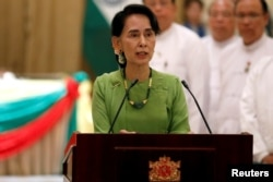 FILE - Aung San Suu Kyi talks during a news conference in Naypyitaw, Myanmar, Sept. 6, 2017.