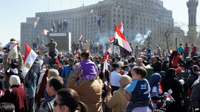 Crowds turn out to celebrate in Cairo's Tahrir Square, marking the success of a popular uprising and honoring the protesters who were killed, February 18, 2011