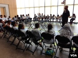 Corporal Sebeke Jefferson leads a Gang Awareness class during Cops Camp in Maryland, July 2015. (J. Taboh/VOA)