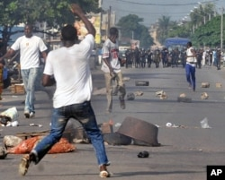 Several dozens of Ivorian opposition youth clash with police during a demonstration on 17 Feb 2010 in Abidjan against the dissolution of Ivorian cabinet and electoral commission