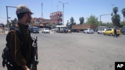 A fighter with the al-Qaida-inspired Islamic State of Iraq and the Levant (ISIL) takes control of a traffic intersection in the northern Iraqi city of Mosul, June 22, 2014.