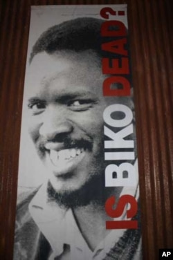 A large poster of anti-apartheid activist, Steve Biko, on one of the museum's memory boxes', which are made out of the same rusted metal as locals use to construct their shacks