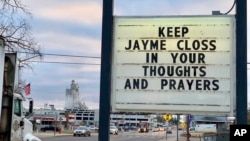 A sign is seen in the small town of Barron, Wis., Oct. 23, 2018, where 13-year-old Jayme Closs was discovered missing Oct. 15 after her parents were found fatally shot at their home.