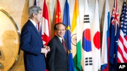 Secretary of State John Kerry, left, walks with Secretary-General of Association of Southeast Asian Nations (ASEAN), Le Luong Minh to their meeting on Sunday, Feb. 16, 2014.