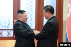 FILE - North Korean leader Kim Jong Un meets President Xi Jinping in Beijing, China, in this photo released by North Korea's Korean Central News Agency (KCNA).