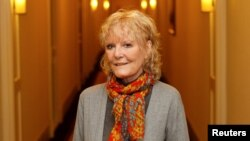 FILE - Singer Petula Clark poses in New York, Jan. 19, 2012.