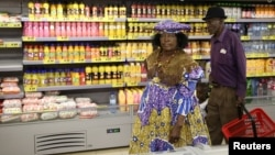 FILE - A Herero woman shops at a Shoprite store in Otjinene Village in the Omaheke Region, Namibia, Feb. 22, 2017.