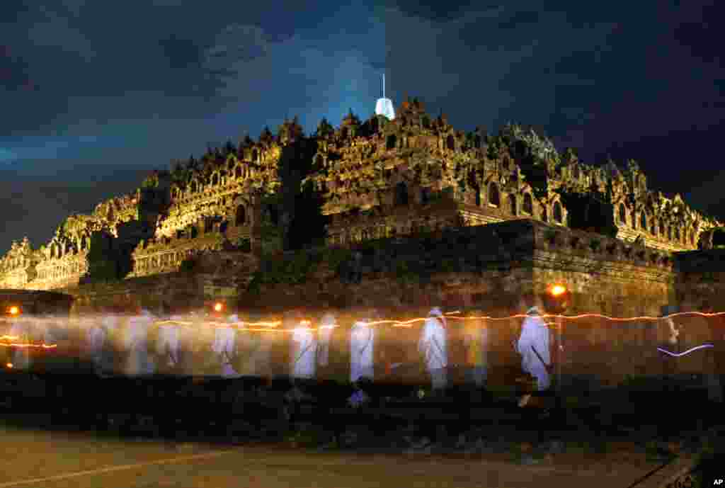 May 17: Indonesian Buddhists walk around Borobudur temple during a celebration of Vesak day, which marks the birth, enlightenment and demise of Buddha, in Central Java, Indonesia. (AP)