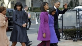 President Barack Obama, waves as he walks with his daughters Sasha and Malia, first lady Michelle Obama and mother-in-law Marian Robinson to St. John's Church in Washington, January 21, 2013, for a church service during the 57th Presidential Inauguration.