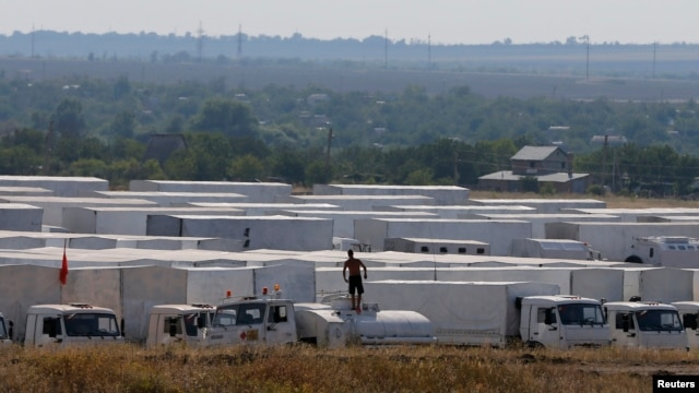 A Russian convoy of trucks said to be carrying humanitarian aid for eastern Ukraine is seen parked near Kamensk-Shakhtinsky, Rostov Region, August 14, 2014.