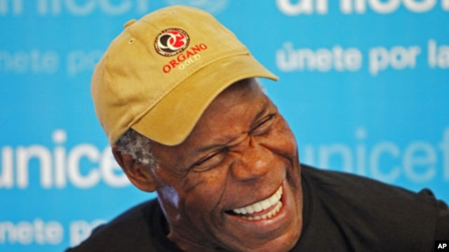 UNICEF Ambassador and actor Danny Glover laughs during an event in Lima October 20, 2010 (file photo)