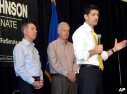 House Speaker Paul Ryan joins Wisconsin state Assembly Speaker Robin Vos, left, and Sen. Ron Johnson, R-Wis., center, at a campaign rally for Johnson in Burlington, Wis., May 5, 2016.