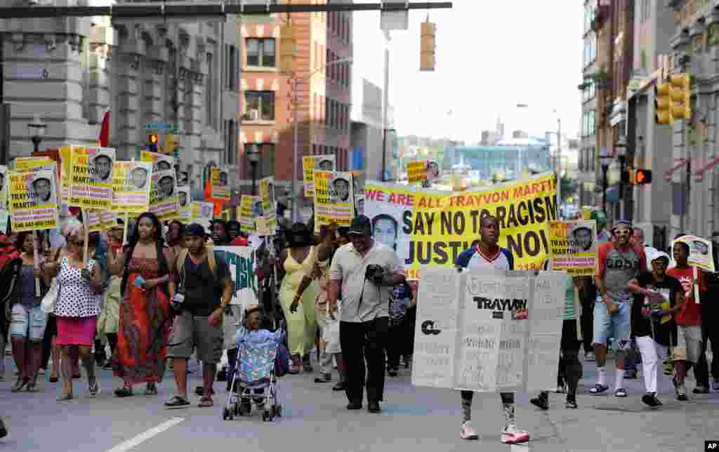 Protesters march during a demonstration in reaction to the acquittal of neighborhood watch volunteer George Zimmerman, Baltimore, Maryland, July 15, 2013.