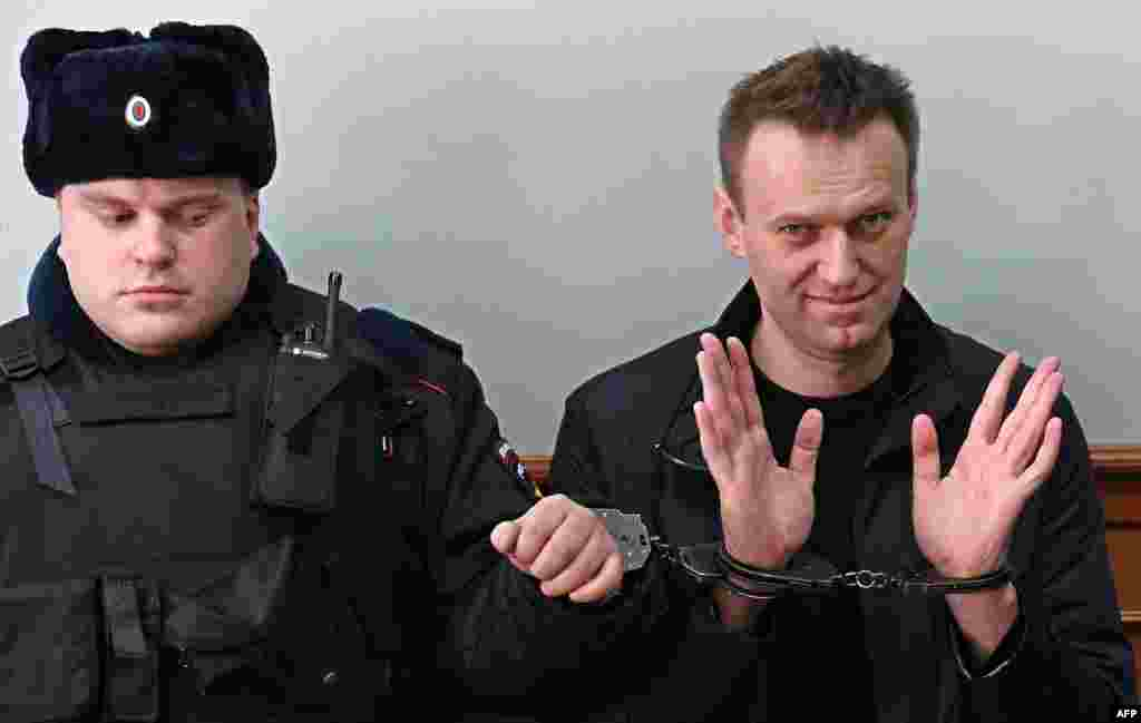 Kremlin critic Alexei Navalny, who was arrested during a March 26 anti-corruption rally, gestures during an appeal hearing at a court in Moscow, Russia.