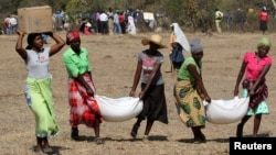 Villagers collect their monthly food aid provided by United Nations World Food Programme (WFP) in Bhayu, Zimbabwe, September 14, 2016.