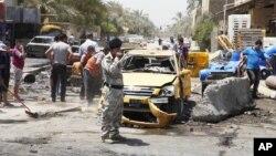 23일 이라크 바그다드 인근의 폭탄 테러 현장.