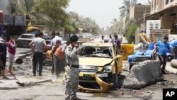 Iroq poytaxti Bag'dodning Sadr tumanidagi xurujda so'ng, 23-iyul, 2012-yil.