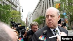 FILE - Lawyer John Dowd is met with reporters as he exits Manhattan Federal Court in New York, NY, U.S., May 11, 2011.