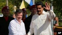 哥倫比亞總統桑托斯(左)本月早些時候在與委內瑞拉總統馬杜羅(右)會面。