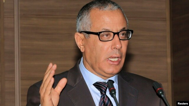 Libyan Prime Minister Ali Zeidan tried to rally support after militiamen surrounded the Foreign Ministry in Tripoli.