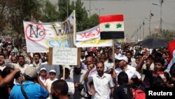 Supporters of religious and political leader Muqtada al-Sadr demonstrate against the possibility of a U.S. military strike against the Syrian government, in Baghdad's Sadr City August 30, 2013.