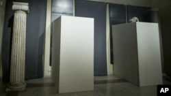 Plywood panels cover naked statues inside the Campidoglio, Capitol Hill, during a meeting between Italian Premier Matteo Renzi and Iranian President Hassan Rouhani, in Rome, Italy, Jan. 25, 2016.