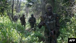 African Union-led Ugandan soldiers search for LRA rebels in the Central African Republic on June 24, 2014. (AFP PHOTO/MICHEL SIBILONI)