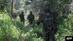FILE - Soldiers of the Uganda People's Defense Force (UPDF) patrol in the jungle in the Central African Republic as they look for Lord's Resistance Army (LRA) fighters.