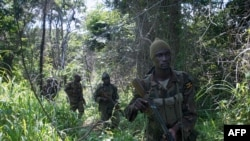 FILE - Soldiers of the Uganda People's Defence Force (UPDF) patrol in the jungle in CAR looking for LRA.