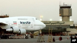 FILE - In this June 2003 file photo, a Boeing 747 of Iran's national airline is seen at Mehrabad International Airport in Tehran. Boeing Co. is negotiating a deal to sell 100 airplanes to Iran, state-run media reported Sunday, June 19, 2016 a sale potentially worth billions that would mark the first major entry of an American company into the Islamic Republic after last year's nuclear deal. (AP Photo/Hasan Sarbakhshian, File)