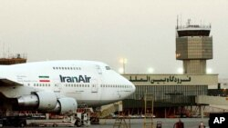 FILE - A Boeing 747 of Iran's national airline is seen at Mehrabad International Airport in Tehran, June 2003.