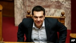 Greece's Prime Minister Alexis Tsipras takes his seat to attend a parliamentary session ahead of a vote, in Athens, Dec. 15, 2015.