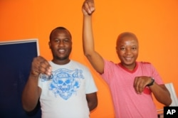 Mahoota (right) and another kwaito stalwart, record label manager Gao Mokone, do the 'Potoko' dance
