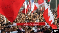 Anti-government protesters march in a parade welcoming newly released political prisoners to the Pearl roundabout in Manama, Bahrain, February 23, 2011