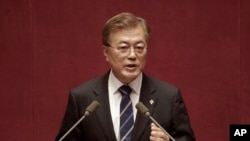 FILE - South Korean President Moon Jae-in delivers a speech at the National Assembly in Seoul, South Korea.