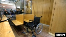 The wheelchair of former Rwandan army captain Pascal Simbikangwa is seen before the start of his trial at Paris court, Feb. 4, 2014.