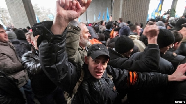 People attend a rally organized mainly by ethnic Russians near the Crimean parliament building in Simferopol,  Feb. 26, 2014.