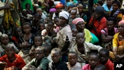 Refugees who fled Burundi's violence and political tension wait to board a ship freighted by the UN, at Kagunga on Lake Tanganyika, Tanzania, May 23, 2015, to be taken to the port city of Kigoma.