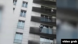 Video shows Mamoudou Gassama, 22, risking his life on Sunday as he climbed up the balconies to rescue the four-year-old who is clinging to a railing and glancing at the ground below, while horrified onlookers watched.