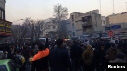 People protest in Tehran, Iran Dec. 30, 2017, in this still image from a video obtained by Reuters.