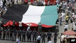 Followers of the Jordanian Muslim Brotherhood march in Amman, demanding more political reforms, July 13, 2012.