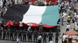 Followers of the Jordanian Muslim Brotherhood march in Amman, demanding more political reforms, July 13, 2012.