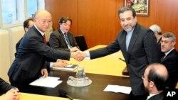 عباس عراقچی در دیدار با یوکیا آمانو، مدیر کل آژانس بین المللی انرژی اتمی